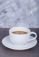 coffee on wood table and wall background