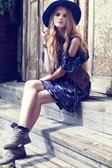 Beautiful woman wearing boho chic clothes.