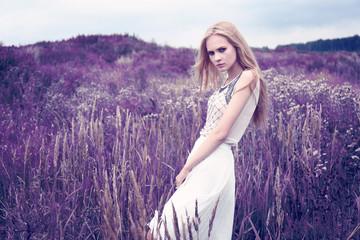 Beautiful romantic woman in the field.