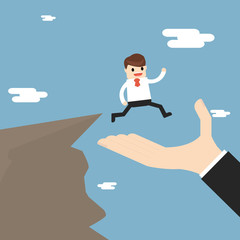 Business Partnership And Support. businessman is walking to the cliff but the big hand offers to support him.