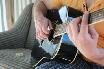 guitar string man hand outdoor