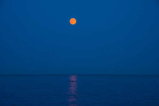 Strawberry Moon on the Ocean