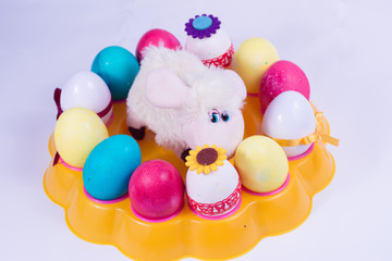 Easter Bunny with Easter eggs on a white background