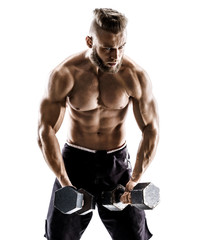 Muscular male does the exercises with dumbbells on white background. Photo of strong male with naked torso. Strength and motivation.