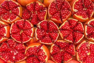 Red pomegranate background, close up