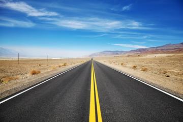 Endless desert road, travel concept.