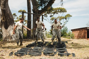 Trainer giving training to military soldiers