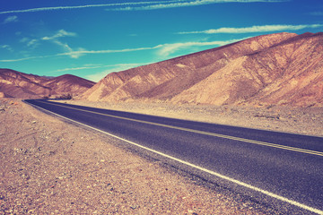 Color stylized desert road in Death Valley, USA.