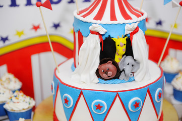 Two-storeyed pie on children's birthday on a subject circus
