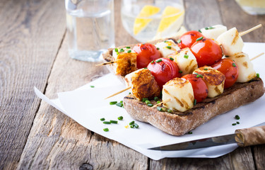 Open grilled  haloumi kebab sandwich with tomato