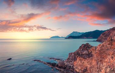 Few minutes before the sunrise on the Mediterranean sea in April. Colorful morning scene in the small bay near Tekirova village