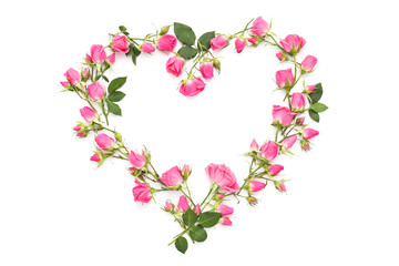 Small pink roses in the shape of heart on a white background