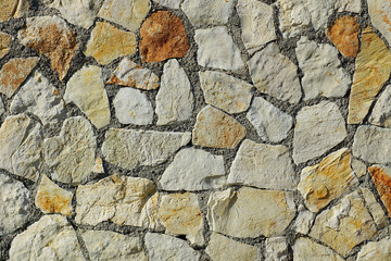 Stone coated wall of a building. Background.