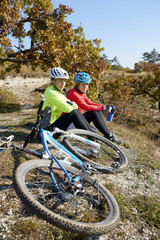 Mountain bikers training at the hillside. A group of female mountain bikers making their way across a rocky hillside.