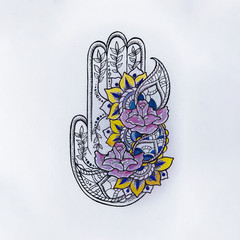 Sketch of hamsa with patterns on white background.