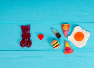 Jelly candies represent in the form of a burger, pizza and drink that gummy bear love it