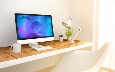 minimalist workplace with online booking computer