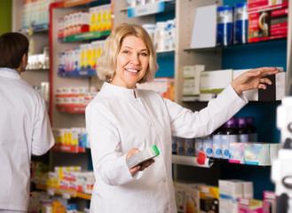 friendly female pharmacist at work