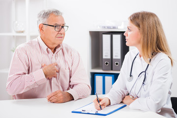 Patient is telling doctor about his health problems. He is having pain in his chest.