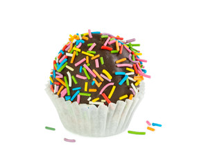 Chocolate cake ball with colorful sprinkles in paper form