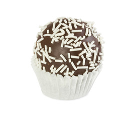 Chocolate cake ball with white sprinkles in paper form