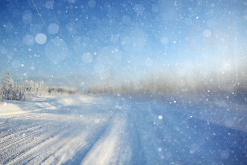 blurred winter background with snowflakes for text