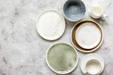 Fototapeta ceramic tableware top view on stone background mock up obraz
