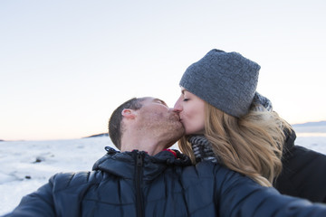 beautiful couple embracing in winter