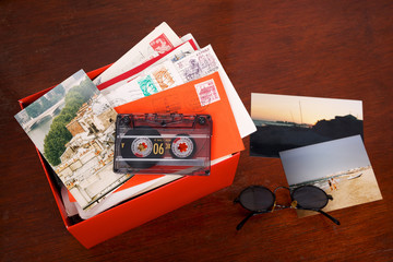 Box filled with letters and photos. Photos where taken in Paris, and on the beach of the Mediterranean Sea. (Near Agde, France)