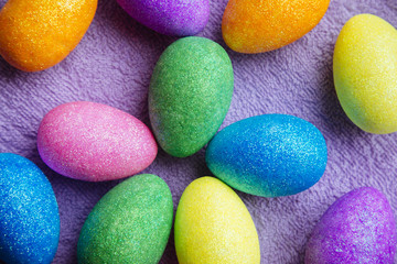 Colorful Easter Eggs on a fabric background. Creative concept
