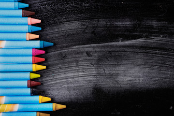 colorful crayons on the board for drawing