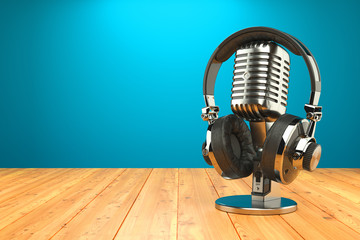 Studio microphone and professional headphones on wood table. 3d render