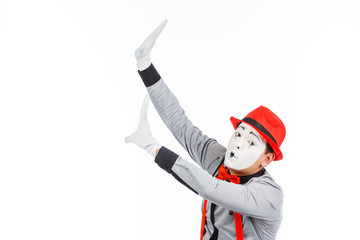 Portrait of a man, an artist, a pantomime. Shows something, isolated on white background