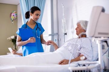 Female doctor examining senior woman