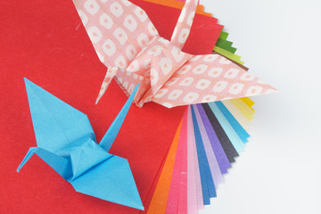Colorful origami papers on white background