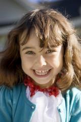 Portrait of girl (4-5) smiling