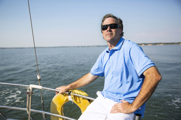 Man relaxing on private yacht
