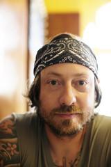 Portrait of tattooed mature man