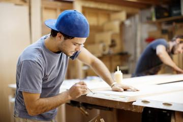 Carpenters building furniture in workshop