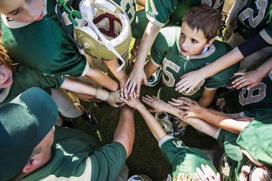 Boys (10-11) greeting before american football match