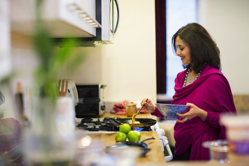 Woman preparing meal in kitchen