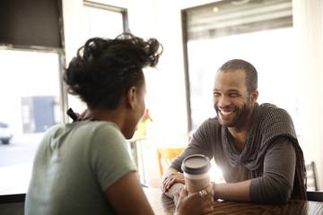 Female bartender and smiling customer talking