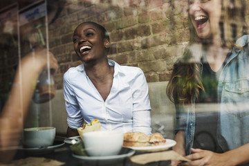 Smiling woman sitting in cafe