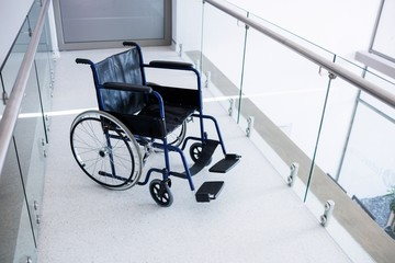 Empty wheelchair in the passageway Wall mural