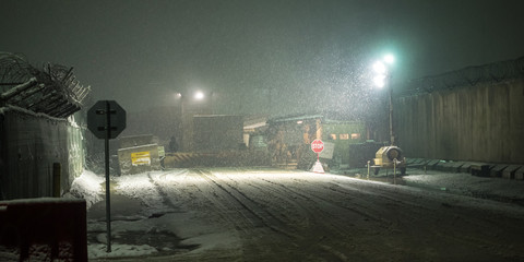 Guard Gate on Military Installation in Afghanistan during snow at Night