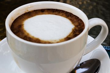 Hot coffee in a white cup