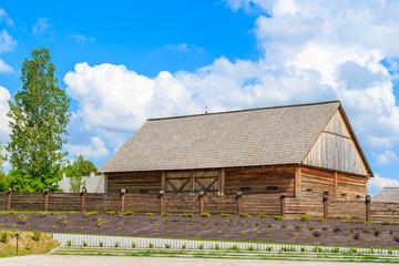 Old wooden barn in Tokarnia village on sunny spring day, Poland