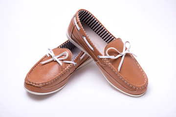 Baby brown loafers on white background