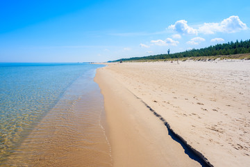 Crystal clear calm sea water on Lubiatowo beach, Baltic Sea, Poland