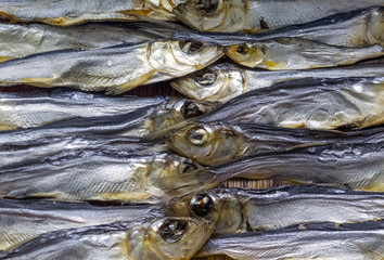 A pile of dried salted fish. Abstract food background.